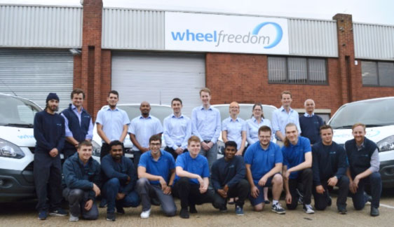 Wheelfreedom Team outside the new building